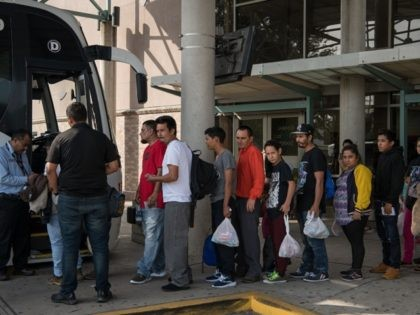 Central American migrant families recently released from federal detention wait to board a bus at a bus depot on June 12, 2019, in McAllen, Texas. (Photo by Loren ELLIOTT / AFP) (Photo credit should read LOREN ELLIOTT/AFP via Getty Images)