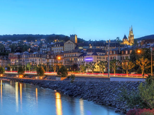 Night view of the waterfront in Neuchatel, Switzerland.