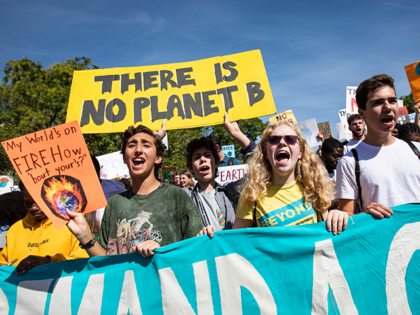 Activists gather in John Marshall Park for the Global Climate Strike protests on September 20, 2019 in Washington, United States. In what could be the largest climate protest in history and inspired by the teenage Swedish activist Greta Thunberg, people around the world are taking to the streets to demand …