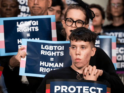 Activists rally in support of LGBTQ rights at New York City Hall on October 8, 2019 in New York City. On Tuesday the U.S. Supreme Court will hear three cases on whether it is legal to fire workers because of their sexual orientation or gender identity. The cases on Tuesday …
