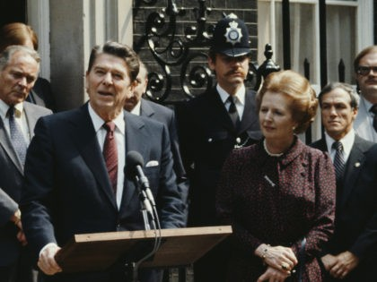 US President Ronald Reagan makes a speech outside 10 Downing Street during a state visit to London, UK, 9th June 1982. British Prime Minister Margaret Thatcher is standing to the right and US Secretary of State Alexander Haig is behind and to the left of Reagan. (Photo by Fox Photos/Hulton …