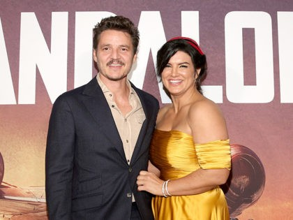"""HOLLYWOOD, CALIFORNIA - NOVEMBER 13: Pedro Pascal and Gina Carano arrive at the premiere of Lucasfilm's first-ever, live-action series, """"The Mandalorian,"""" at the El Capitan Theatre in Hollywood, Calif. on November 13, 2019. """"The Mandalorian"""" streams exclusively on Disney+. (Photo by Jesse Grant/Getty Images for Disney)"""