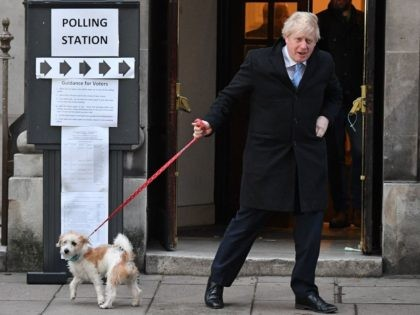 TOPSHOT - Britain's Prime Minister Boris Johnson and his dog Dilyn leave from a Polling Station, after he cast his ballot paper and voted, in central London on December 12, 2019, as Britain holds a general election. (Photo by DANIEL LEAL-OLIVAS / AFP) (Photo by DANIEL LEAL-OLIVAS/AFP via Getty Images)