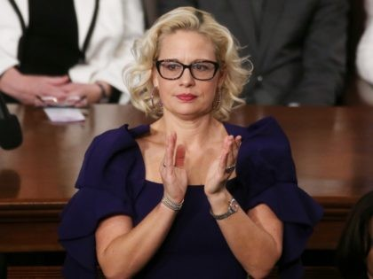WASHINGTON, DC - FEBRUARY 04: Sen. Krysten Sinema (D-AZ) applauds during the State of the Union address in the chamber of the U.S. House of Representatives on February 04, 2020 in Washington, DC. President Trump delivers his third State of the Union to the nation the night before the U.S. …