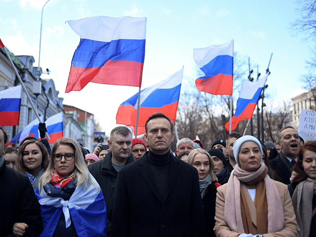 Russian opposition leader Alexei Navalny, his wife Yulia, opposition politician Lyubov Sobol and other demonstrators march in memory of murdered Kremlin critic Boris Nemtsov in downtown Moscow on February 29, 2020. (Photo by Kirill KUDRYAVTSEV / AFP) (Photo by KIRILL KUDRYAVTSEV/AFP via Getty Images)