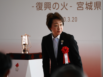 Seiko Hashimoto, minister for the Tokyo Olympic and Paralympic Games, attends a ceremony to display the Olympic flame at Ishinomaki Minamihama Tsunami Recovery Memorial Park in Ishinomaki, Miyagi prefecture on March 20, 2020, after its arrival from Greece. (Photo by CHARLY TRIBALLEAU / AFP) (Photo by CHARLY TRIBALLEAU/AFP via Getty …