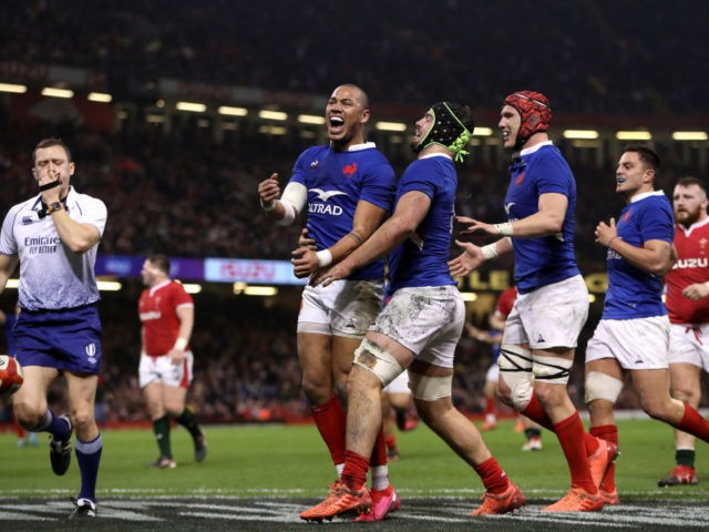 CARDIFF, WALES - FEBRUARY 22: Gael Fickou of France celebrates after scoring a try which was later disallowed by TMO due to a forward pass during the 2020 Guinness Six Nations match between Wales and France at Principality Stadium on February 22, 2020 in Cardiff, Wales. (Photo by David Rogers/Getty …