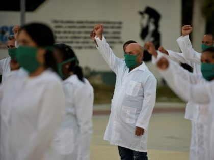 Doctors and nurses of Cuba's Henry Reeve International Medical Brigade take part in a farewell ceremony before traveling to Andorra to help in the fight against the coronavirus COVID-19 pandemic, at the Central Unit of Medical Cooperation in Havana, on March 28, 2020. (Photo by YAMIL LAGE / AFP) (Photo …