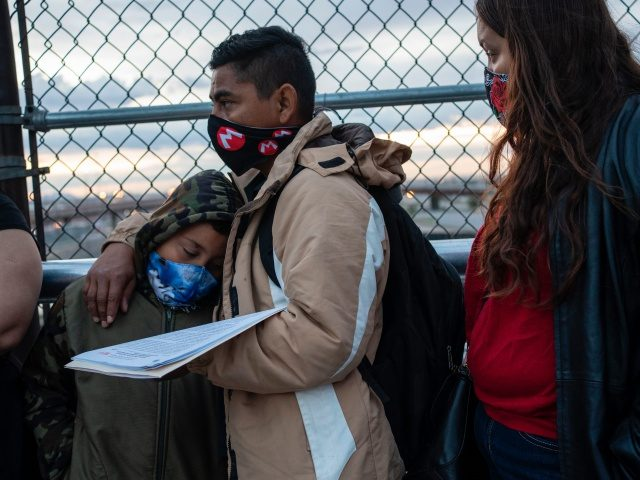 Cesar, 35, an asylum seeker from Nicaragua waits with his wife, Carolina, 25, (Right) and his eight-year-old son Donovan to enter the US port of entry to change their asylum court dates on April 6, 2020 at the Paso del Norte International Bridge in Ciudad Jua?rez in the state of …