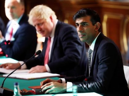 LONDON, ENGLAND - JULY 21: Prime Minister Boris Johnson sits beside Chancellor of the Exchequer Rishi Sunak during a face-to-face meeting of his cabinet team of ministers, the first since mid-March, at the Foreign and Commonwealth Office (FCO) on July 21, 2020 in London, England. The meeting in the FCO …