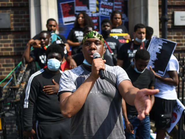 LONDON, ENGLAND - AUGUST 08: Protesters gather outside Tottenham Police station on August 8, 2020 in London, England. The protest was held to demand changes in the police force including an end to 'overpolicing of Black communities' and the use of excessive force and tasers. It marks the anniversary of …