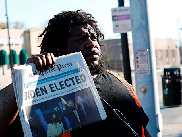"David Woods sells the Sunday Detroit Free Press on Livernois and Seven Mile Road announcing that Joe Biden has been declared President-elect on November 8, 2020 in Detroit, Michigan. - One of the most prominent Republicans in the US Congress on Sunday urged Donald Trump to ""fight hard"" and not …"