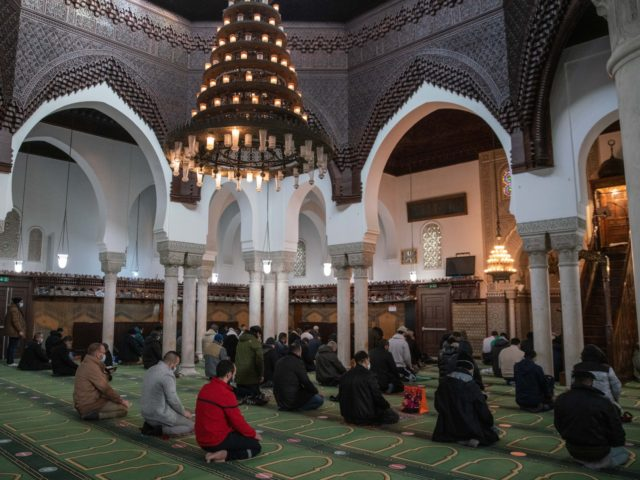 PARIS, FRANCE - DECEMBER 11: Worshipers in prayer during Friday prayers at the Grand Mosque mosque of Paris on December 11, 2020 in Paris, France. France's 3.7 million Muslim population accounts for the largest Muslim community in Western Europe. A series of terrorist attacks in recent years has prompted the …