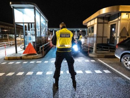 A picture taken on December 22, 2020 in Malmo, Sweden, shows control patrols and vehicles at the border crossing on the Oresund Bridge, which connects Denmark and Sweden (Copenhagen and Malmö). - Sweden blocked travel from neigbouring Denmark starting midnight on December 22, 2020, after a new mutation of the …