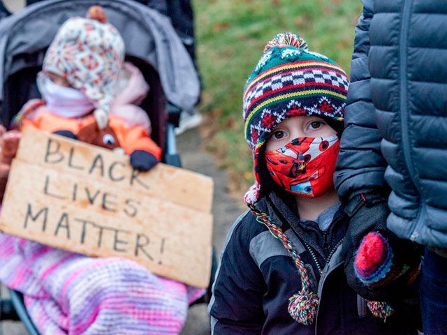 Protestors in support of Black Lives Matter brought their children to rally against the police killing of Andre Hill in the neighborhood where Hill was shot, in Columbus, Ohio on December 24, 2020. - The killing of an unarmed African-American man by police in the US city of Columbus, Ohio …