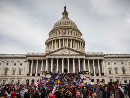 WASHINGTON, DC - JANUARY 06: A large group of pro-Trump protesters stand on the East steps of the Capitol Building after storming its grounds on January 6, 2021 in Washington, DC. A pro-Trump mob stormed the Capitol, breaking windows and clashing with police officers. Trump supporters gathered in the nation's …