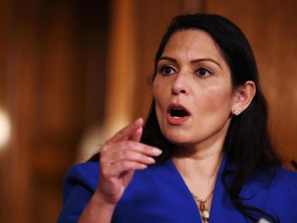 Britain's Home Secretary Priti Patel attends a COVID-19 pandemic virtual press conference inside 10 Downing Street in central London on January 12, 2021. - People who flout coronavirus lockdown rules were on Tuesday warned that police will take action, as the government vowed to step up enforcement measures to cut …