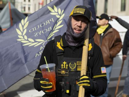 A member of the Proud Boys speaks to the media at a gun rights rally near the Capitol in Richmond, Virginia on January 18, 2021. - Pro-Trump protests planned at state capitols nationwide got off to a quiet start with only small groups of armed demonstrators gathering in states including …