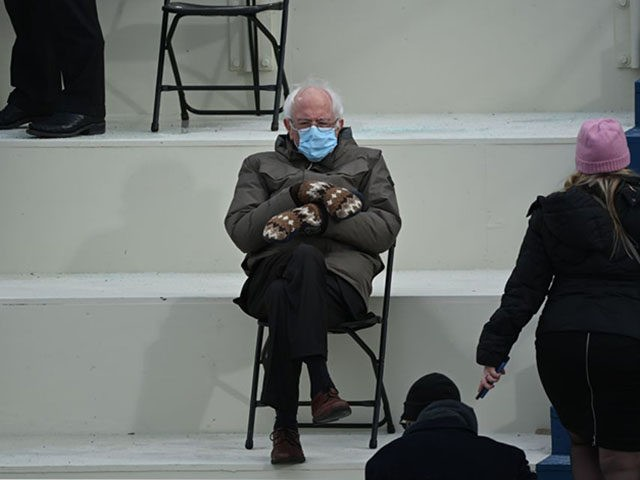 TOPSHOT - Former presidential candidate, Senator Bernie Sanders (D-Vermont) sits in the bleachers on Capitol Hill before Joe Biden is sworn in as the 46th US President on January 20, 2021, at the US Capitol in Washington, DC. (Photo by Brendan SMIALOWSKI / AFP) (Photo by BRENDAN SMIALOWSKI/AFP via Getty …