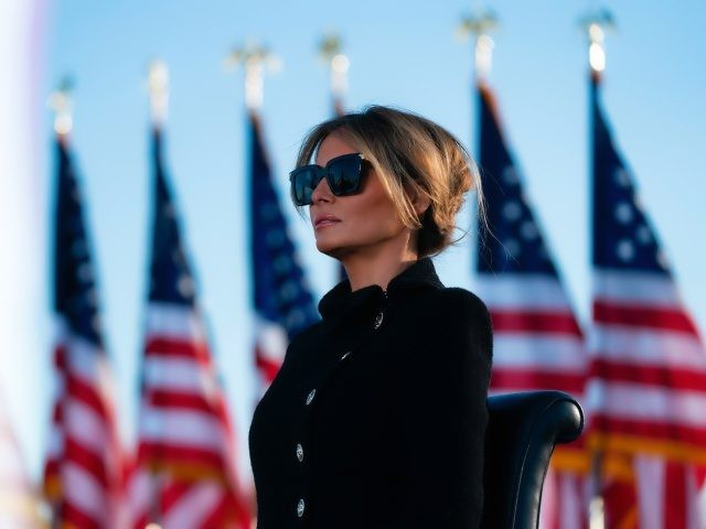 Melania Trump listens as her husband Outgoing US President Donald Trump addresses guests at Joint Base Andrews in Maryland on January 20, 2021. - President Trump and the First Lady travel to their Mar-a-Lago golf club residence in Palm Beach, Florida, and will not attend the inauguration for President-elect Joe …
