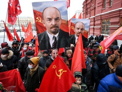 Russian Communist Party supporters walk towards the mausoleum of Russian communist revolutionary Vladimir Ilyich Ulyanov, also known as Lenin, to take part in a memorial ceremony marking the 97th anniversary of his death at Red Square in downtown Moscow on January 21, 2021. (Photo by Kirill KUDRYAVTSEV / AFP) (Photo …