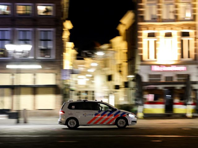 A Dutch police car patrols in the deserted streets of Den Bosch during the curfew time, on January 26, 2021, a day after police clashed with groups of demonstrators protesting against the introduction of new measures, including the curfew, to fight against the spread of the Covid-19. (Photo by Kenzo …