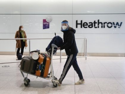 "LONDON, ENGLAND - JANUARY 30: Travelers arrive at Heathrow Terminal 2 on January 30, 2021 in London, England. The UK government has added flights from the UAE to the ""red list"" of countries banned from flying into the UK. The Department for Transport says the aim is ""to prevent the …"
