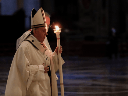 Pope Francis holds a candle as he arrives to celebrate Mass on the occasion of the celebration of the World Day of Consecrated Life at St. Peter's Basilica in the Vatican on February 2, 2021. (Photo by Andrew Medichini / POOL / AFP) (Photo by ANDREW MEDICHINI/POOL/AFP via Getty Images)
