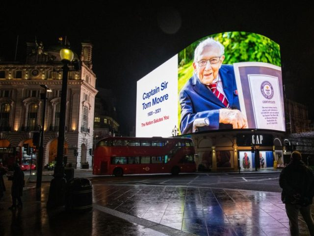 LONDON, ENGLAND - FEBRUARY 02: A tribute to Captain Sir Tom Moore is displayed at Piccadilly Circus shortly after it was announced that he has died on February 2, 2021 in London, England. Sir Tom had raised more than £33 million for NHS charities ahead of his 100th birthday last …