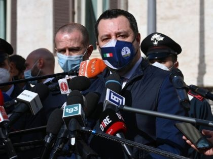 Head of the Lega Nord (Northern League) party and senator Matteo Salvini (R) addresses the media outside Palazzo Montecitorio, seat of the lower house of parliament, following a meeting with Mario Draghi on February 6, 2021 in Rome. - Italy's Mario Draghi continued detailed talks on February 6 on the …