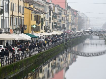 People enjoy bar and restaurant's terraces and stroll along the Naviglio canal in Milan on February 6, 2021, as the Italian government eased anti-Covid restrictions in the Lombardy region, during the Covid-19 pandemic. (Photo by MIGUEL MEDINA / AFP) (Photo by MIGUEL MEDINA/AFP via Getty Images)