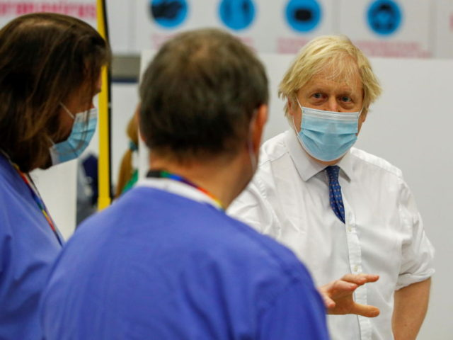 DERBY, ENGLAND - FEBRUARY 08: UK Prime Minister Boris Johnson visits a vaccination centre at the Derby Arena velodrome on February 7, 2021 in Derby, England. (Photo by Phil Noble - WPA Pool/Getty Images)