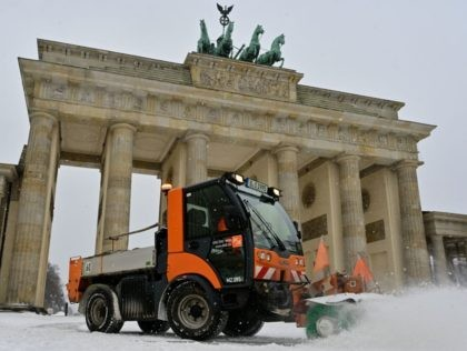 Snow is cleared in front of the Brandenburg Gate after fresh snowfall on February 8, 2021 in Berlin. (Photo by John MACDOUGALL / AFP) (Photo by JOHN MACDOUGALL/AFP via Getty Images)