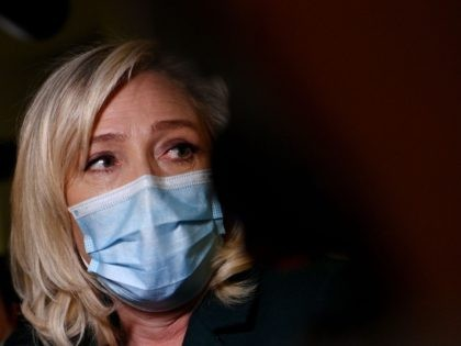 Head of far-right party Rassemblement National (RN) Marine Le Pen answers the press as she leaves after a hearing in her trial for tweeting images of the Islamic State group's atrocities in 2015, in Nanterre, west of Paris on February 10, 2021. - Le Pen goes on trial on charges …