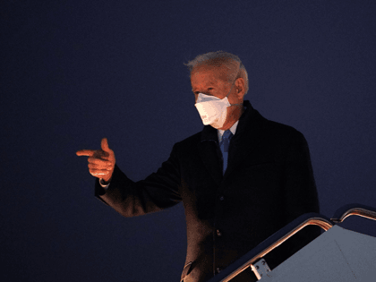 US President Joe Biden gestures as he boards Air Force One before departing from Andrews Air Force Base in Maryland on February 12, 2021. - Biden is heading the Camp David presidential retreat where he is due to spend the weekend. (Photo by MANDEL NGAN / AFP) (Photo by MANDEL …
