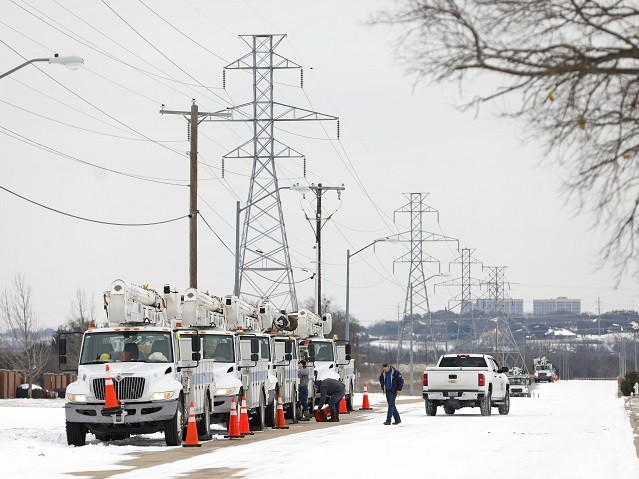 FORT WORTH, TX - FEBRUARY 16: Pike Electric service trucks line up after a snow storm on February 16, 2021 in Fort Worth, Texas. Winter storm Uri has brought historic cold weather and power outages to Texas as storms have swept across 26 states with a mix of freezing temperatures …
