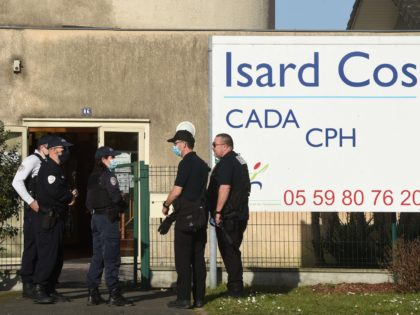 Police officers stand at the entrance of the Isard COS Reception Centre for Asylum Seekers (CADA) in Pau, where a manager has been stabbed to death by an asylum seeker in Pau, southwestern france, on February 19, 2021. - The victim, a 46-year-old father, was stabbed to death by a …