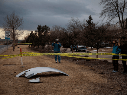 Residents take pictures of debris fallen from a United Airlines airplane's engine on the neighborhood of Broomfield, outside Denver, Colorado, on February 20, 2021 - A United Airlines flight suffered a fiery engine failure February 20, shortly after taking off from Denver on its way to Hawaii, dropping massive debris …