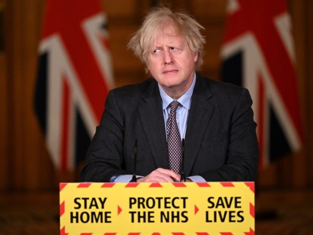 TOPSHOT - Britain's Prime Minister Boris Johnson attends a virtual press conference inside 10 Downing Street in central London on February 22, 2021, after he earlier set out the Government's roadmap out of the third Covid-19 lockdown. - British Prime Minister Boris Johnson on Monday set out a four-step plan …