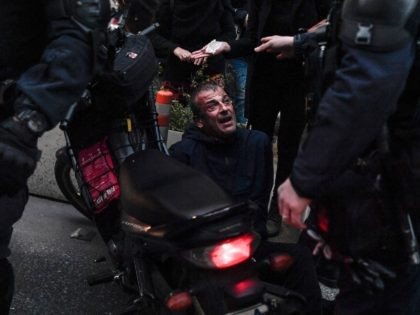 Motorised police officers detain a protester during a demonstration in Athens on February 24, 2021, in support to a jailed far left group member on hunger strike since 48 days. - Dimitris Koufodinas, 62, has been in intensive care since last week following his campaign to push for his transfer …