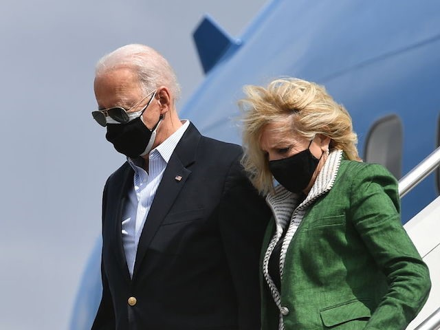 US President Joe Biden and First Lady Jill Biden step off Air Force One upon arrival at Ellington Field Joint Reserve Base in Houston, Texas on February 26, 2021. - Biden is visiting Houston, Texas following severe winter storms which left much of the state without electricity for days. (Photo …