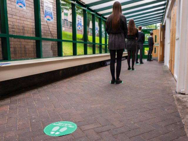 HYDE, ENGLAND - JULY 16: Pupils queue to enter the canteen at Longdendale High School on July 16, 2020 in Hyde, England. The Government plan to spend GBP 1 billion to help pupils catch up with their education before September after spending months out of school during the coronavirus lockdown. …