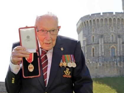 WINDSOR, ENGLAND - JULY 17: Captain Sir Thomas Moore poses after being awarded with the insignia of Knight Bachelor by Queen Elizabeth II at Windsor Castle on July 17, 2020 in Windsor, England. British World War II veteran Captain Tom Moore raised over £32 million for the NHS during the …