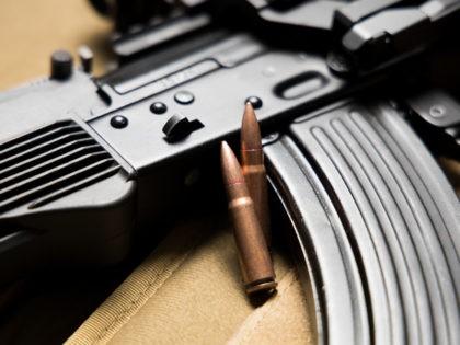 Closeup of a Kalashnikov MKK-104 assault rifle with bullets. 7.62x39 mm. Modern AK-47.