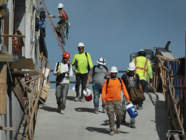 MIAMI, FLORIDA - SEPTEMBER 04: Construction workers are seen on a job site on September 04, 2020 in Miami, Florida. The Bureau of Labor Statistics released a report today that shows the unemployment rate fell to 8.4 percent last month, down from a COVID-19 pandemic peak of 14.7 percent in …