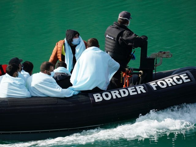 DOVER, ENGLAND - SEPTEMBER 10: The UK Border Force disembark migrants at Dover Marina after being intercepted in the English Channel on September 10, 2020 in Dover, England. More than 1,468 migrants, some of them children, crossed the English Channel by small boat in August, despite a commitment from British …