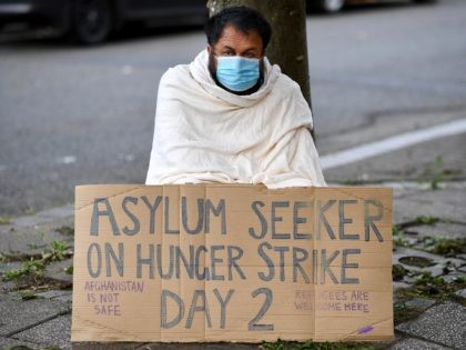GLASGOW, SCOTLAND - SEPTEMBER 23: Abdul Safi, an Afghan asylum seeker, is joined by fellow Afghani's as he hunger strikes outside the Home Office building on September 23, 2020 in Glasgow, Scotland. Mr Safi has stitched his lips together and gone on hunger strike in a last-ditch attempt to get …