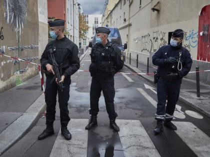 PARIS, FRANCE - SEPTEMBER 25: Armed police secure the area of around the former Charlie Hebdo headquarters, and scene of a previous terrorist attack in 2015, after two people were stabbed on September 25, 2020 in Paris, France. French National Anti-terrorist Prosecutor's office have opened an investigation into the attempted …