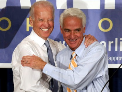 In this 2014 file photo, then Vice President Joe Biden stands with former Florida Governor Charlie Crist during a campaign event. (Joe Raedle/Getty Images)