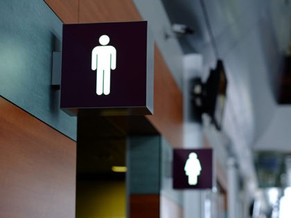 entrance to the male and female toilet. Sign in airport.